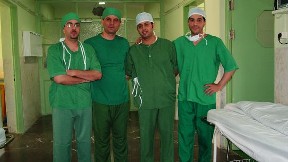 Dr. Allan Sossan (second from left) is shown with some of the residents from the medical school in Tehran, Iran. Sossan spent two weeks in Tehran performing surgery and teaching.