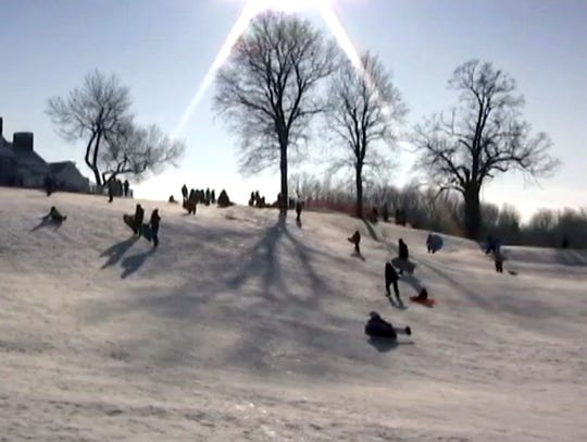 Sledders glide down the Whitnall Park Golf Course hill that has multiple levels and pitches to explore, plus a warming area in the park's clubhouse.