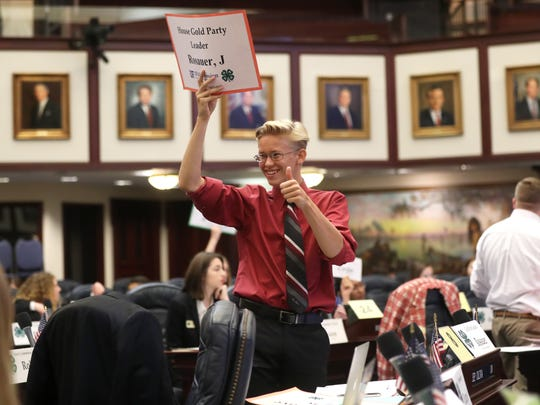Jeremy Rosauer of Lee County signals to a friend as