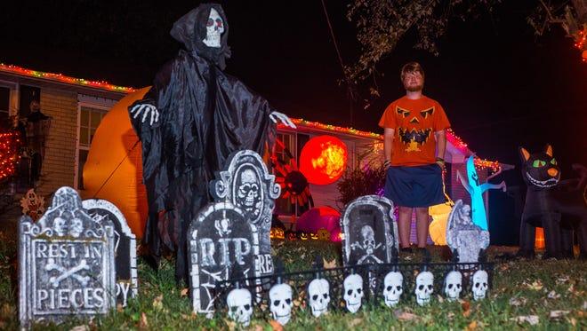 Chandler Anderson stands amid his Halloween display on Keystone Lane in Hendersonville.