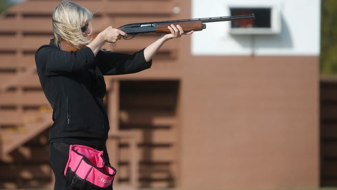State Attorney General candidate Teresa Hensley takes aim at a clay target while trap shooting at the Andy Dalton Shooting Range on Wednesday, November 2, 2016.