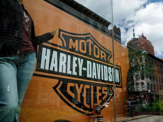 The Harley Davidson logo in a window of Harley-Davidson