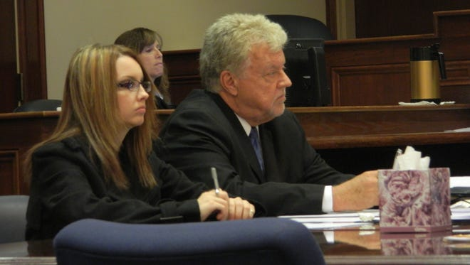 Nicole Pamblanco and her lawyer, Mike Flanagan, at her trial in April