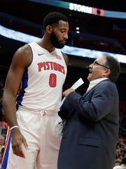 Stan Van Gundy, right, talks to Andre Drummond during the first half against the Bucks on Nov. 3.
