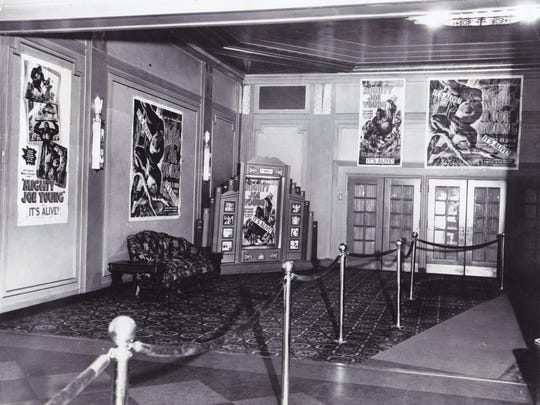"A view of the Flynn lobby in 1949 with posters for the movie ""Mighty Joe Young."""