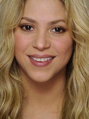 Colombian singer Shakira poses for photographs during an interview with The Associated Press in Barcelona, Spain. Shakira says she has given birth to a boy her second child with partner, Spanish football star Gerard Pique. In a statement on her official Twitter account Friday, Jan. 30, 2015, Shakira, 37, said Sasha Pique Mebarak was born Thursday at 9.54 p.m. in Barcelona, Spain.