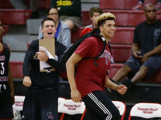 Red Mountain High basketball player Timmy Allen cheers for his teammates during their game against Cactus Shadows High during Paradise Valley Thanksgiving Basketball tournament at Paradise Valley High School on Nov. 22, 2016 in Phoenix, Ariz.