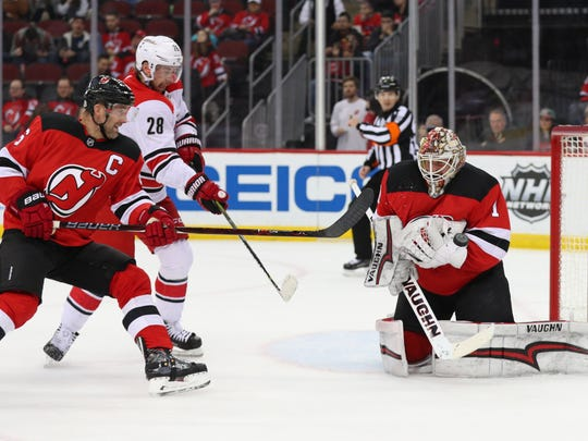 New Jersey Devils goaltender Keith Kinkaid (1) makes a save during the first period of their game against the Carolina Hurricanes at Prudential Center on Thursday, Feb. 15, 2018, in Newark.