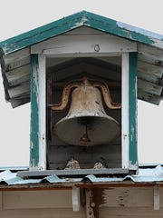 The old school bell still sits in the belfry above the school house in Stillwater.