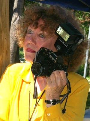 Barbara is hardly ever seen without her camera.