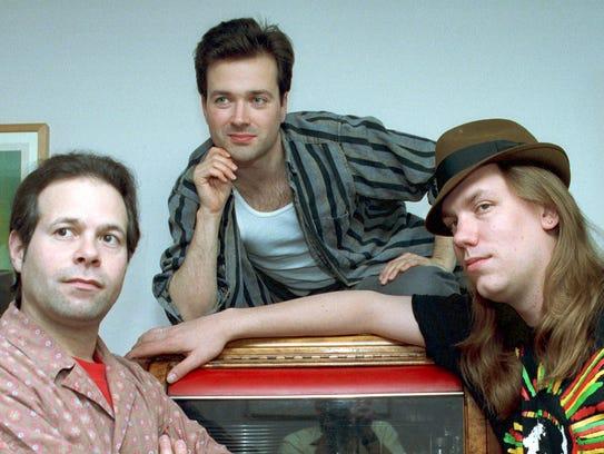Victor DeLorenzo, left, Gordon Gano, center, and Brian
