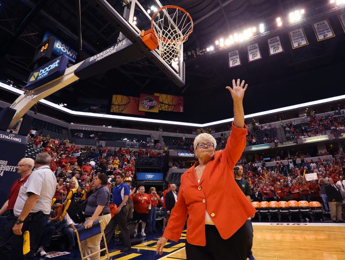 Retiring Indiana Fever Head Coach Lin Dunn acknowledges the cheers of the crowd as she walks off the court at Bankers Life Fieldhouse after the team was eliminated 75-62 by the Chicago Sky in the deciding third game of the WNBA Eastern Conference Finals on Wednesday, September 3, 2014.