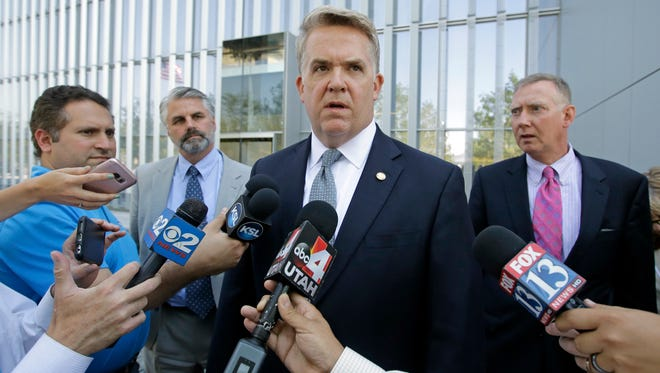 U.S. Attorney John Huber, center, speaks with reporters after leaving the federal courthouse Friday, July 29, 2016, in Salt Lake City at the conclusion of the trial of St. George businessman Jeremy Johnson in a bank fraud case. U.S. Attorney General Jeff Sessions has directed federal prosecutors across the nation to direct their attention toward stopping violent crimes, and a recent wave of filings in the St. George office exemplify that renewed priority, Huber said this week.