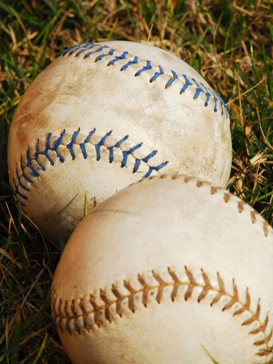 softballs in grass - vertical.jpg