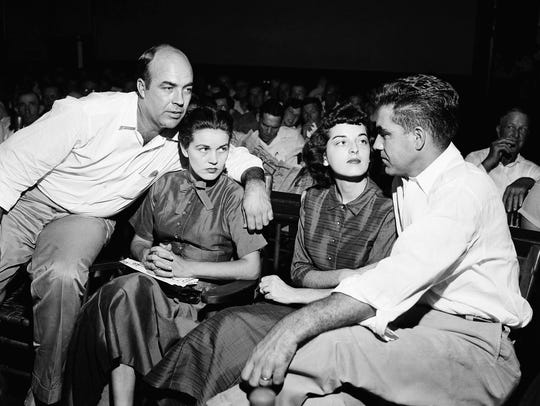 J.W. Milam, left, and Roy Bryant, right, sit with their wives inside a courtroom in Sumner in 1955. An all-white jury acquitted Milam and Bryant in the murder of Emmett Till, only for them to admit their involvement to Look magazine.