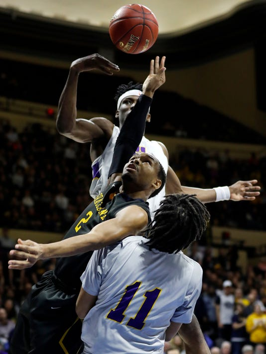 Graceland guard LT Davis, middle, has the ball knocked away by LSU Alexandria forward Brandon Moss, top, as Chris Vickers, bottom, also defends during the first half of the NAIA men's championship college basketball game Tuesday, March 20, 2018, in Kansas City, Mo. (AP Photo/Colin E. Braley)