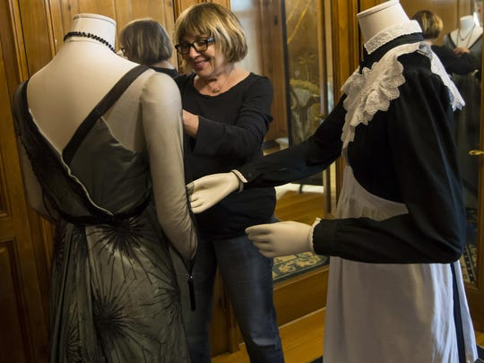 "Nancy Lawson, a costume specialist with the ""Dressing"