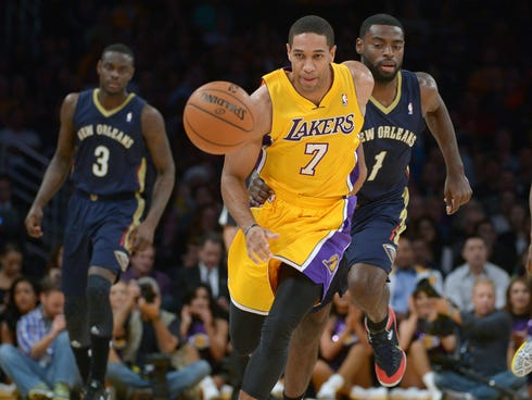 Nov 12, 2013; Los Angeles, CA, USA; Los Angeles Lakers forward Xavier Henry (7) and New Orleans guard Anthony Morrow (3) and guard Tyreke Evans (1) pursue a loose ball at Staples Center. Mandatory Credit: Kirby Lee-USA TODAY Sports