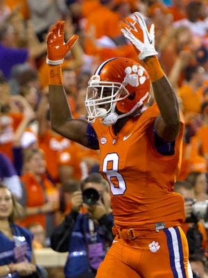 Clemson wide receiver Deon Cain (8) celebrates on the way to the Tigers' win against Florida State.