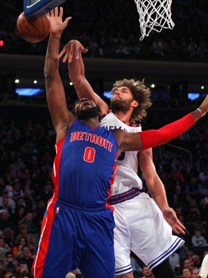 Knicks center Robin Lopez (8) blocks a shot by Pistons center Andre Drummond (0) during the first quarter at Madison Square Garden Tuesday.
