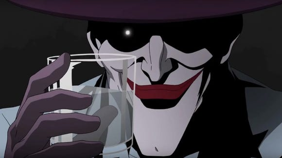 """The Joker (voiced by Mark Hamill) holds up a glass in this scene from the upcoming """"Batman: The Killing Joke."""""""