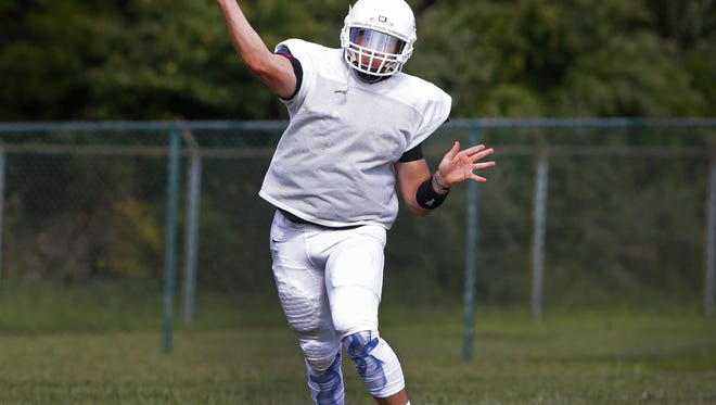Freehold Township High School football quarterback Charles Sabbagh makes a pass during practice at Freehold Twp. High School. Freehold Twp.,NJ.  Friday,  August 19, 2016 Noah K. Murray-Correspondent/Asbury Park Press ASB 0901 Freehold Township Football