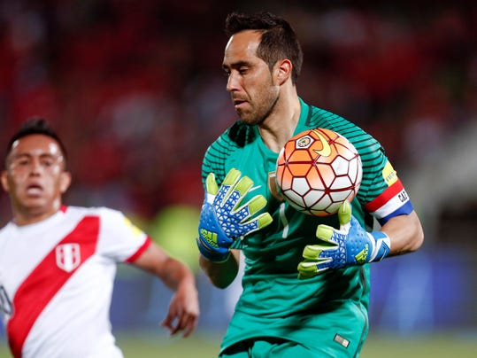 FILE - In this Tuesday, Oct. 11, 2016 file photo, Chile's Claudio Bravo, right, fights for the ball with Peru's Chriristian Cueva during a 2018 World Cup qualifying soccer match in Santiago. Chile coach Juan Antonio Pizzi says Claudio Bravo is fit again and could start in goal against Australia at the Confederations Cup on Sunday. Bravo hasn't played since April 27, when he injured his calf for Manchester City in a derby game with Manchester United. (AP Photo/Luis Hidalgo, File)