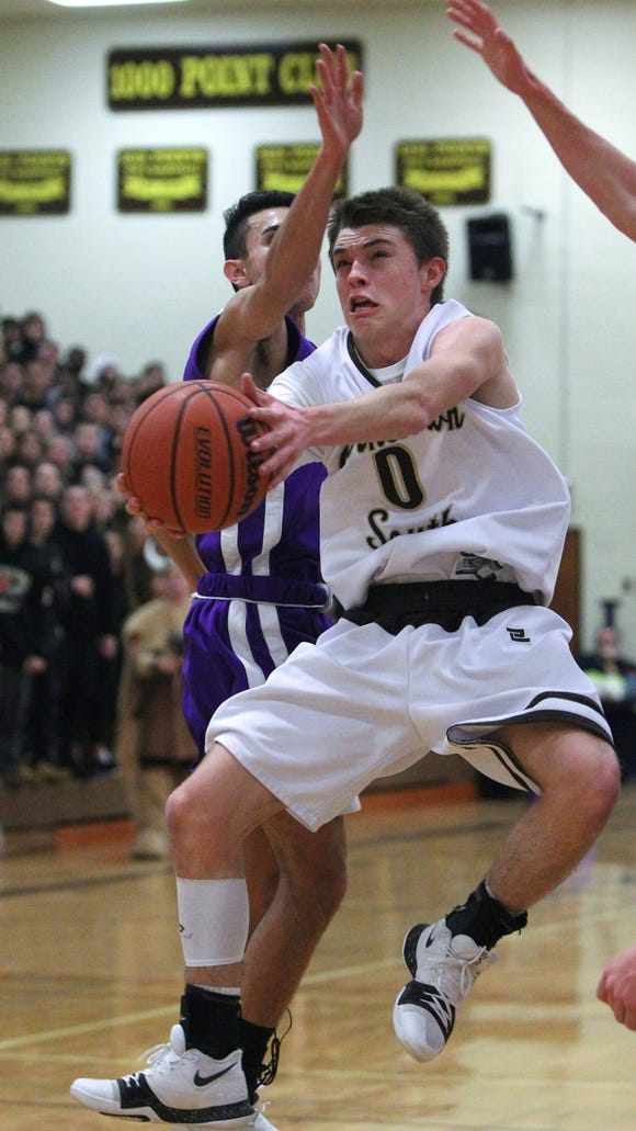 Clarkstown North's Luke Borelli pressures Clarkstown