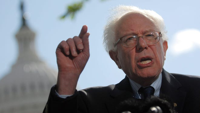 Sen. Bernie Sanders, I-Vt., discusses the need for sweeping changes to Wall Street while outside the U.S. Capitol.