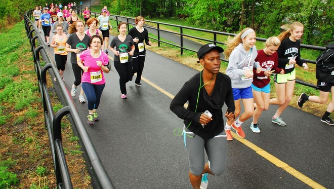 In this file photo, runners take part in the Mid-Hudson Road Runners Club's 2015 Women's Run on the Dutchess Rail Trail.