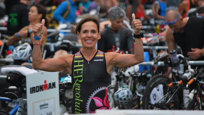 Marlene Sardina-Kelly is shown after the Timberman 703 Half Ironman race in New Hampshire in August 2014. She finished in 5:46, placing 9th in the 50-54 female age group division.