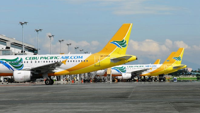 Cebu Pacific fleet at Ninoy Aquino International Airport Terminal 3. The low-cost carrier is expected to start serving Guam beginning in late December or early January 2016.
