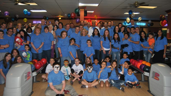 Participants pose for a photo at last year's Bowl for Kids' Sake event