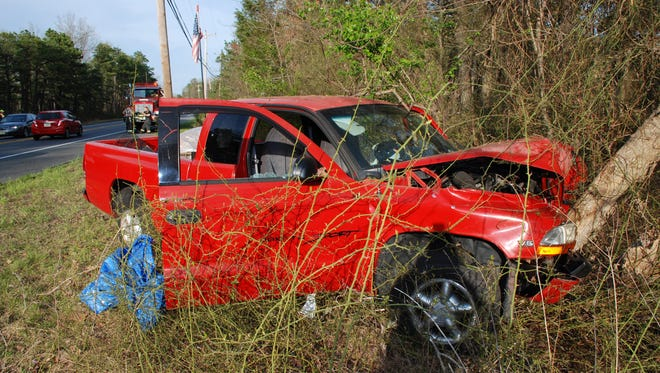 A 1999 Dodge Dakota pickup  is seen after crashing into the woods on Rt. 70 in Manchester on April 25.