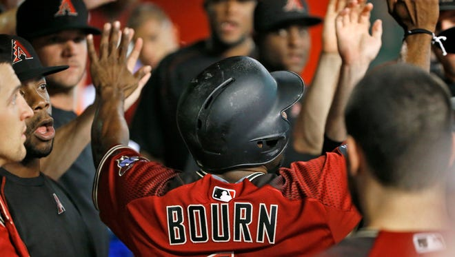 Arizona Diamondbacks' Michael Bourn celebrates his run scored against the Los Angeles Dodgers during the first inning of a baseball game Sunday, July 17, 2016, in Phoenix.