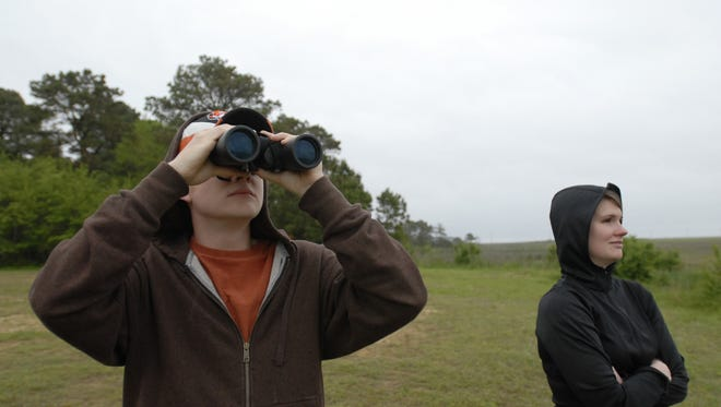 Ron Smith and his sister Tara, both of Virginia Beach, watch from the NASA Wallops Visitor Center for the 2009 launch of the Mintaur I rocket from Wallops Island. The center is upgrading its viewing facilities with a portion of a $600,000 grant.