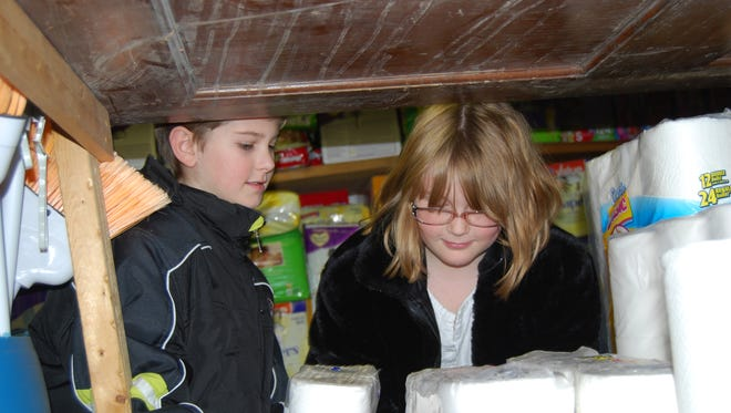 Students help stock shelves in a storage pantry at Welcome House in Covington. Northern Kentucky's Welcome House Outreach willhostSummer Sunday, a fundraising event for Welcome HouseAug.6at Grandview Tavern & Grille in Fort Mitchell.