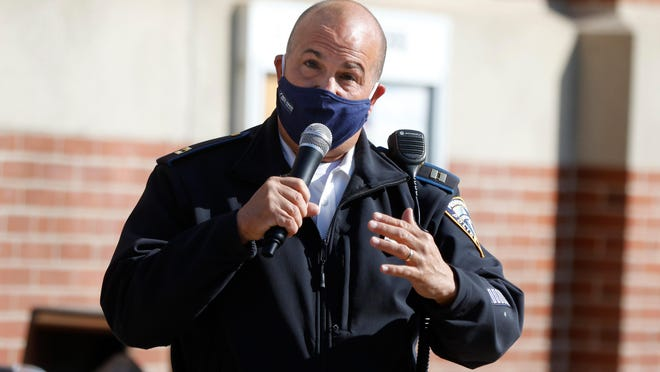 Providence police Capt. Richard Fernandes address the issue of crime in the Elmhurst community during a Sunday morning outdoor community meeting at the Robert F. Kennedy Elementary School.