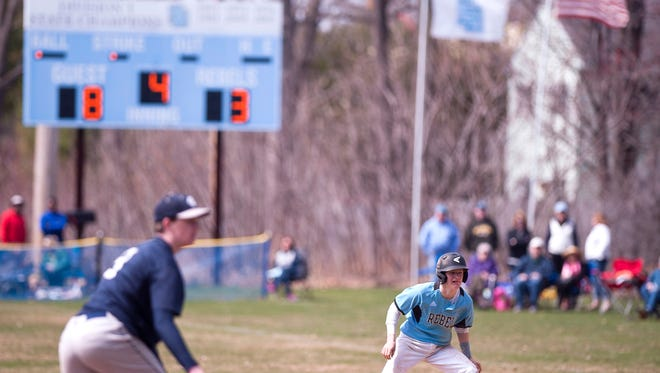 A South Burlington baserunner watches a pitch during the fourth inning of Saturday's baseball game against Mount Mansfield in South Burlington.