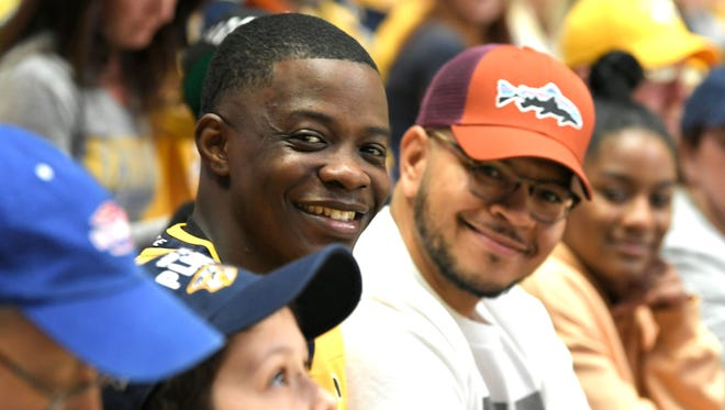 Waffle House hero James Shaw Jr. sits in the stands after being introduced during the first period in Game 2.