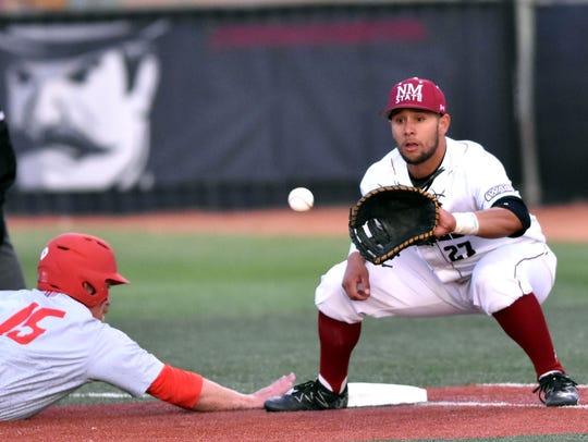 Aggie first baseman Tristen Carranza holds a Lobo base