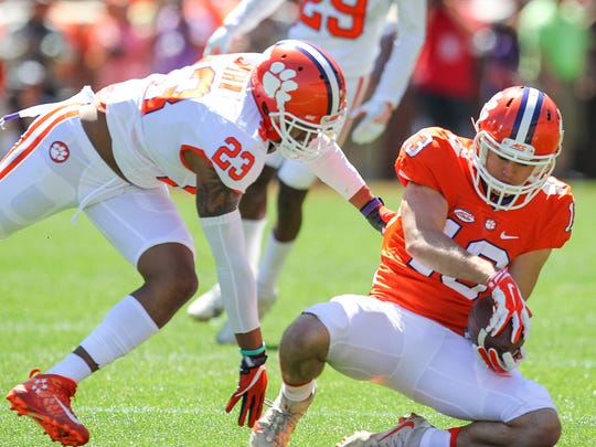 Clemson wide receiver Hunter Renfrow (13), right, catches a ball near Clemson safety Van Smith (23) during Clemson's NCAA college football spring game at Memorial Stadium in Clemson, S.C. on Saturday, April 8, 2017.