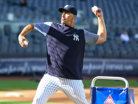 Former New York Yankees pitcher Andy Pettitte throws