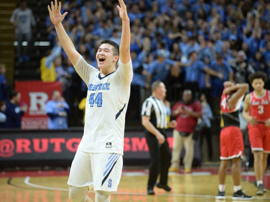 Shawnee's Dylan Deveney celebrates after defeating Newark East Side 56-53 in the Group 4 state final Sunday at Rutgers University.