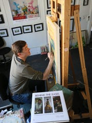 Contemporary realist artist Robert Jackson works on a current painting in his Kennett Square studio.