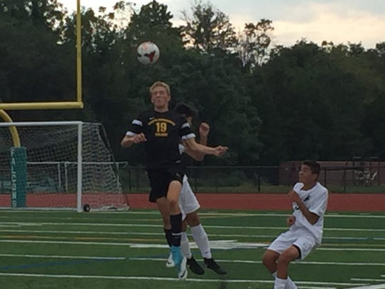 Jake Stump, heading a ball in a game against St. Joseph, is among the South Brunswick boys soccer players participating in a charity kickbal tournament.