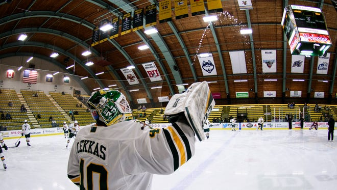 Vermont goalie Stefanos Lekkas (40) squirts water onto the ice during warmups during the men's hockey game between the UMass Minutemen and the Vermont Catamounts at Gutterson Fieldhouse on Friday night January 12, 2018 in Burlington.