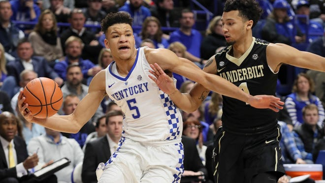 Kentucky's Kevin Knox drives into the lane in the first half against Vanderbilt's Yanni Wetzell.  