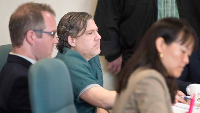 James Scarola, center, appears in Vermont Superior Court in Burlington last October. Scarola is accused of aggravated attempted murder and first-degree aggravated domestic assault on his now ex-wife, Colleen Bray.