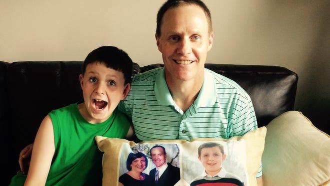 """WROC-TV weatherman Scott Hetsko is home recovering with his son, Logan, after receiving a heart transplant. He spent three months in the hospital, during which he slept with the family photos pillow every night to help him """"focus on the positive."""""""